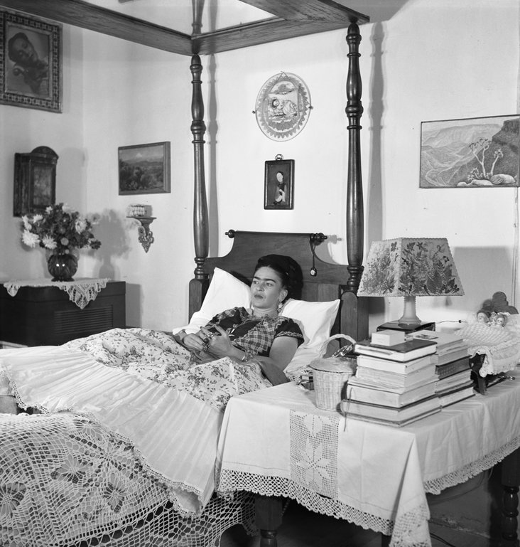Frida Kahlo, wife of Rivera, a painter herself (Frida Kahlo in her bed) by Gisèle Freund